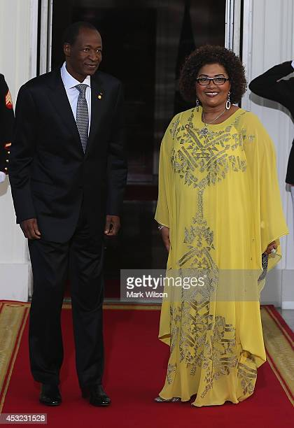 Burkina Faso President Blaise Compaoré and spouse Chantal Compaoré arrive at the North Portico of the White House for a State Dinner on the occasion...