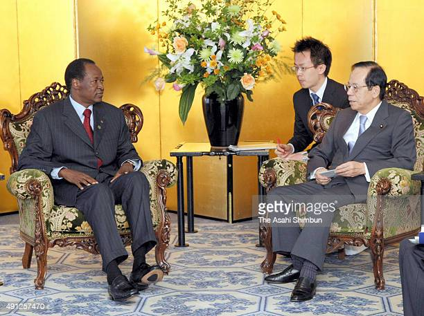 Burkina Faso President Blaise Compaore and Japanese Prime Minister Yasuo Fukuda talk during their meeting ahead of the Tokyo International Conference...