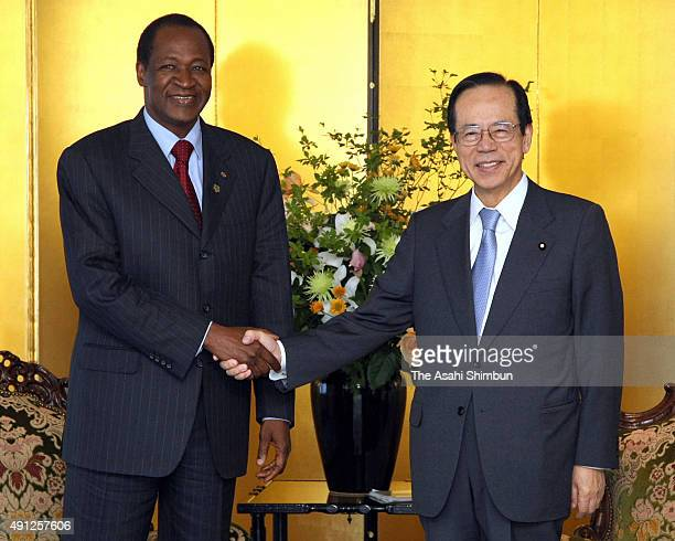 Burkina Faso President Blaise Compaore and Japanese Prime Minister Yasuo Fukuda shake hands during their meeting ahead of the Tokyo International...