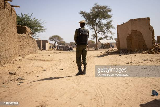 Burkina Faso soldier patrols at a district welcoming Internally Displaced People from northern Burkina Faso in Dori, on February 3, 2020. - 600 000...