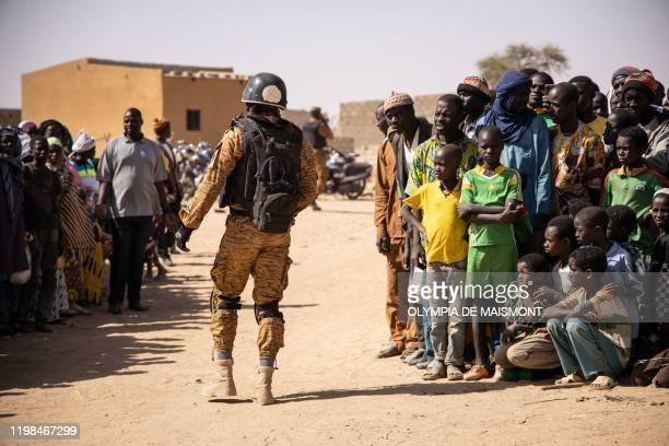 Burkina Faso soldier patrols at district welcoming Internally Displaced People from northern Burkina Faso in Dori, on February 3, 2020. - 600 000...