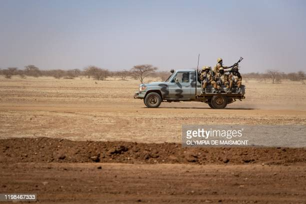 Burkina Faso soldiers patrol aboard a pick-up truck on the road from Dori to the Goudebo refugee camp, on February 3, 2020. / The erroneous...
