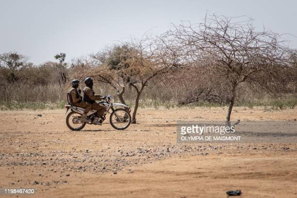 Burkina Faso soldiers patrol at the entrance of the Goudebo refugee camp for Malian refugees in Dori, on February 3, 2020. - More than 8 000 Malian...