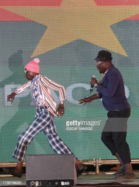 Burkina Faso's actors Souké and Siriki perform at the Yennega Stallion trophy of the 26th Pan-African Film and Television Festival during the closing...