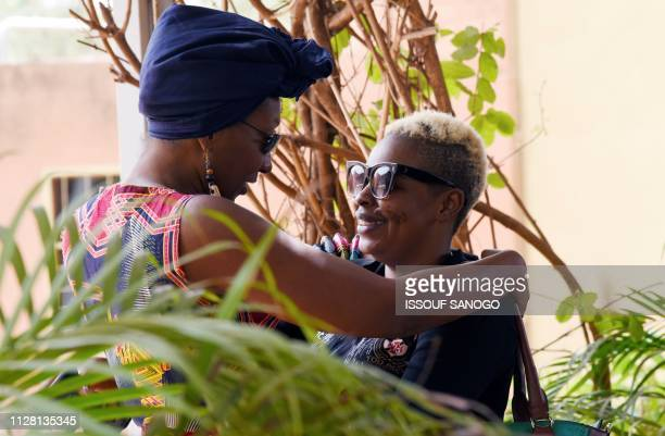 Burkina Faso's actress Azata Soro hugs French actress Nadege Beausson Diagne on Febuary 28 at the Panafrican Film and Television Festival of...