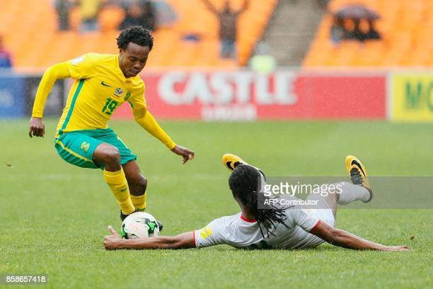 Burkina Faso's Bakary Kone tackles South Africa's Percy Tau during the Fifa World Cup 2018 qualifying football match at Soccer City stadium on...