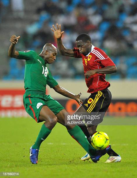 Burkina Faso's Charles Kabore vies with Angola's Miguel Geraldo Quiami during the Africa Cup of Nations group B football match between Angola and...