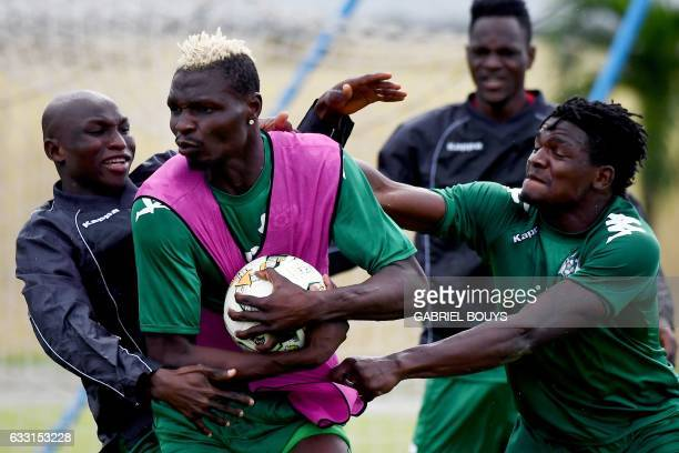 Burkina Faso's forward Aristide Bance Burkina Faso's midfielder Cyrille Bayala and Burkina Faso's defender Patrick Malo play with the ball during a...