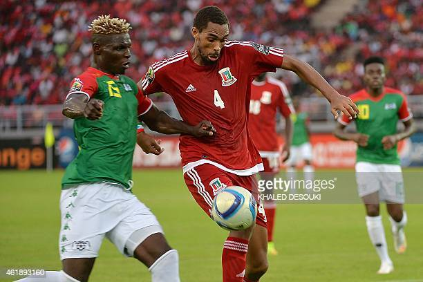Burkina Faso's forward Aristide Bance challenges Equatorial Guinea's defender Rui during the 2015 African Cup of Nations group A football match...