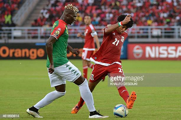 Burkina Faso's forward Aristide Bance challenges Equatorial Guinea's midfielder Ivan Esono during the 2015 African Cup of Nations group A football...