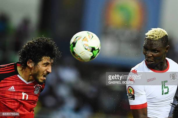 Burkina Faso's forward Aristide Bance heads the ball with Egypt's defender Ahmed Hegazy during the 2017 Africa Cup of Nations semifinal football...