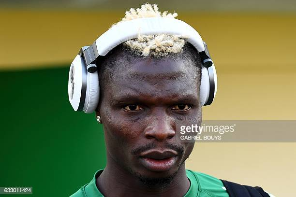 Burkina Faso's forward Aristide Bance listens to music prior to a training session in Libreville on January 29 2017 during the 2017 Africa Cup of...