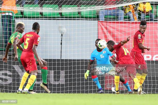 Burkina Faso's goalkeeper Herve Kouakou Koffi prepares to block a header by Ghana's forward Bernard Tekpetey during the 2017 Africa Cup of Nations...
