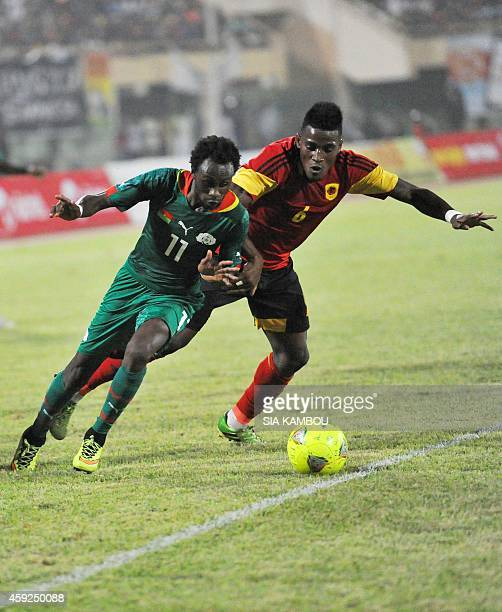 Burkina Faso's Jonathan Pitroipa fights for the ball with Angola's Joaquim Adao during the 2015 Africa Cup of Nations qualifying football match...
