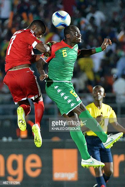 Burkina Faso's midfielder Djakaridja Kone heads the ball with Congo's midfielder Prince Oniangue during the 2015 African Cup of Nations group A...