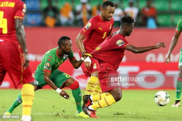 TOPSHOT Burkina Faso's midfielder Ibrahimi Blati Toure challenges Ghana's midfielder Ebenezer Ofori during the 2017 Africa Cup of Nations third place...