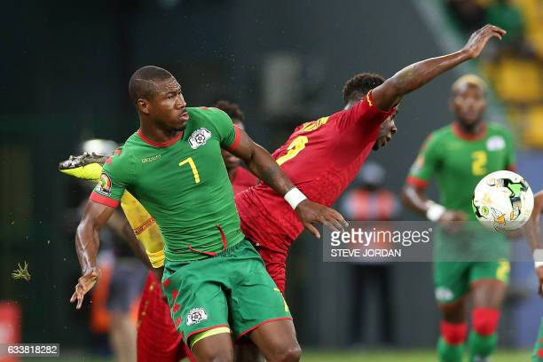 Burkina Faso's midfielder Prejuce Nakoulma challenges Ghana's defender Andy Yiadom during the 2017 Africa Cup of Nations third place football match...