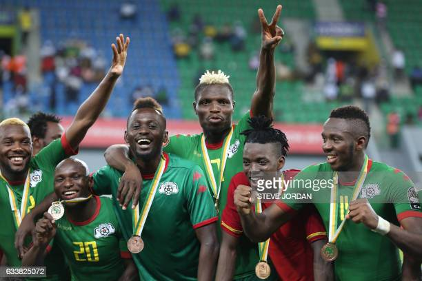 TOPSHOT Burkina Faso's players celebrate with their bronze medals at the end of the 2017 Africa Cup of Nations third place football match between...