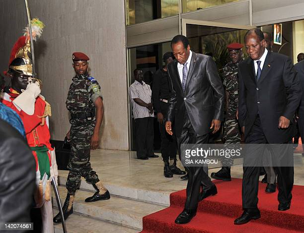 Burkina Faso's President Blaise Compaore and Alassane Ouattara leader of the ECOWAS west African bloc and Ivorian president leave after a meeting of...