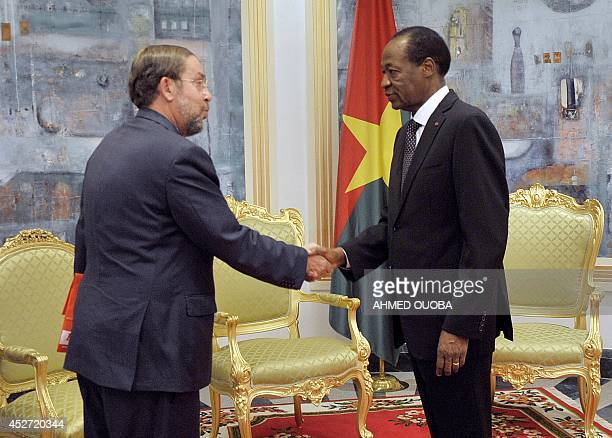 Burkina Faso's President Blaise Compaore and Spain ambassador in Burkina Faso Fernando Moran shake hands during a meeting on July 26 2014 at the...