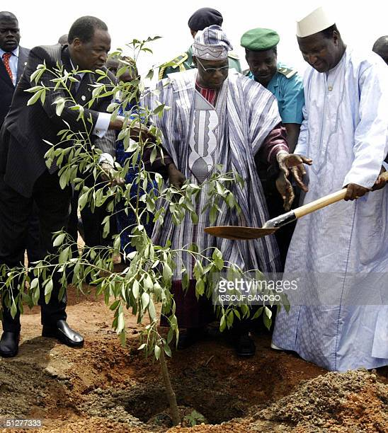 Burkina Faso's President Blaise Compaore his Nigerian counterpart Olusegun Obasajo who is current president of the African Union and Alpha Omar...