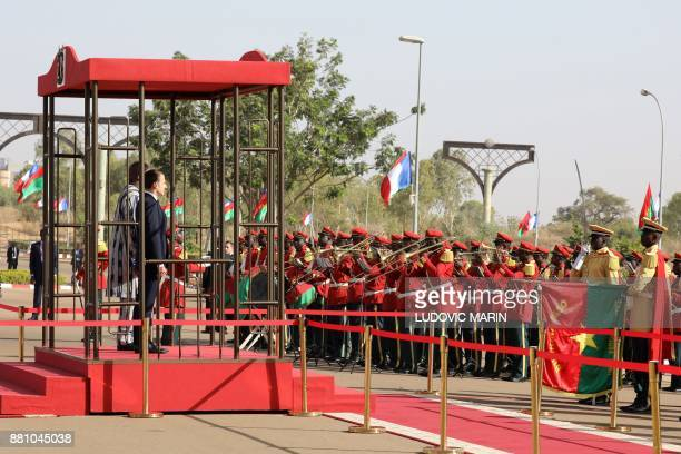 Burkina Faso's President Roch Marc Christian Kabore and French President Emmanuel Macron attend a welcoming ceremony at the Presidential Palace in...