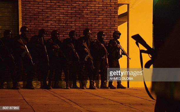 TOPSHOT Burkina Faso's soldiers take position in the surroundings of the hotel Splendide and the cafe Cappuccino during an attack on both the hotel...