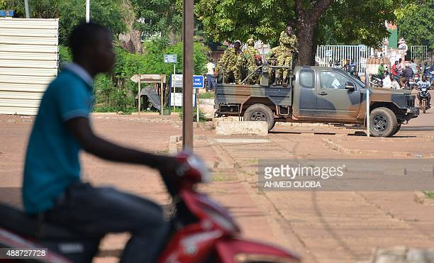 Burkina Faso's troops patroll in Ouagadougou on September 17 2015 Burkina Faso's presidential guard declared a coup a day after seizing the interim...