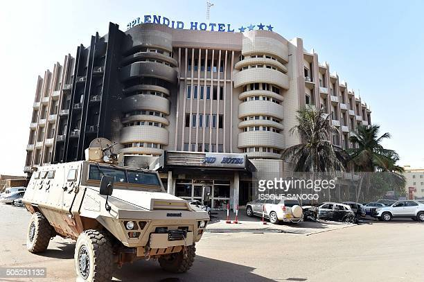 Burkina Faso's troops take position outside the Splendid Hotel and nearby Cappuccino restaurant following a jihadist attack in Ouagadougou on January...