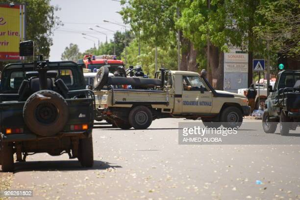 Burkinabe gendarme vehicles block a street in Ouagadougou on March 2 as the capital of Burkina Faso came under multiple attacks targeting the French...