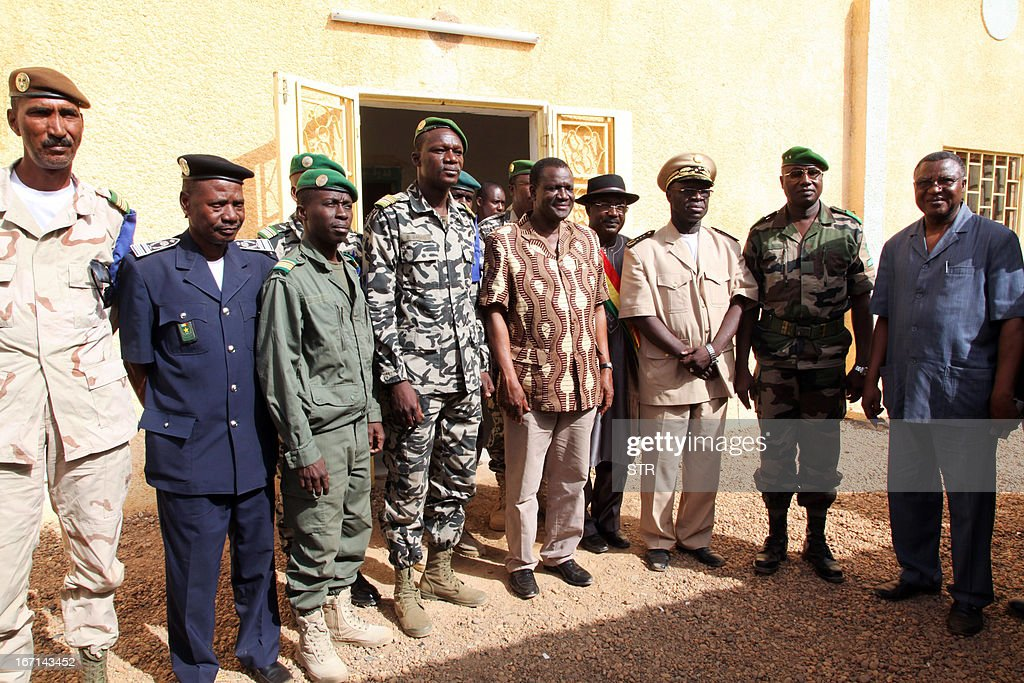 Burkinabe President of the Economic Community of West African States (ECOWAS) Commission, Kadre Desire Ouedraogo (C) poses with military officers during a visit to Franco-African troops in Gao on April 21, 2013. Ouedraogo encouraged Franco-African troops in Mali to 'not release the pressure' against the Islamists armed groups.