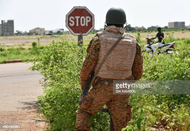 A Burkinabe soldier patrols near to the Presidental Security Regiment military barracks on September 29 2015 in Ouagadougou Burkina Faso's government...