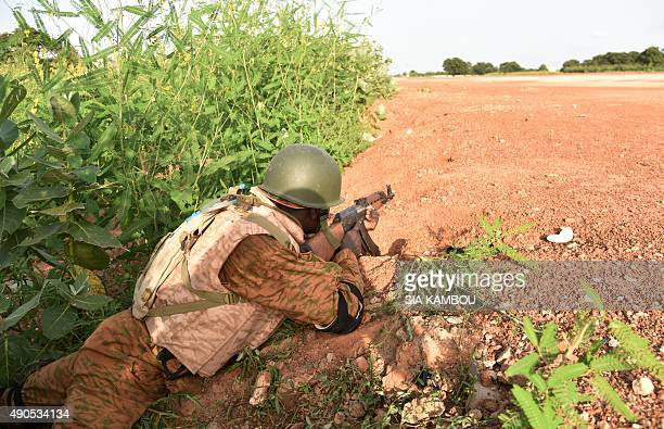 A Burkinabe soldier stands in position near the Presidental Security Regiment military barracks on September 29 2015 in Ouagadougou Burkina Faso's...