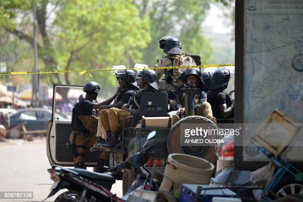 Burkinabe soldiers patrol in Ouagadougou on March 3, 2018 a day after dozens of people were killed in twin attacks on the French embassy and the...