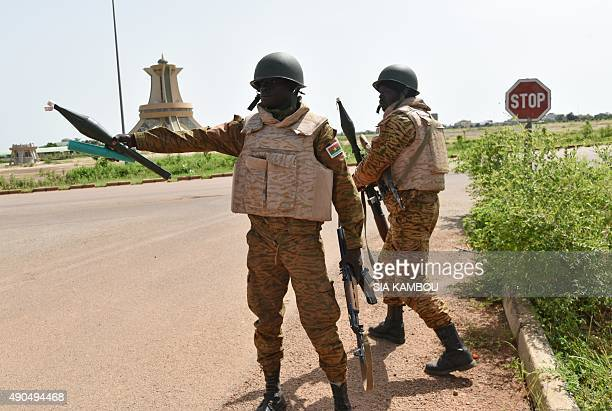 Burkinabe soldiers patrol near to the Presidental Security Regiment military barracks on September 29 2015 in Ouagadougou Burkina Faso's government...