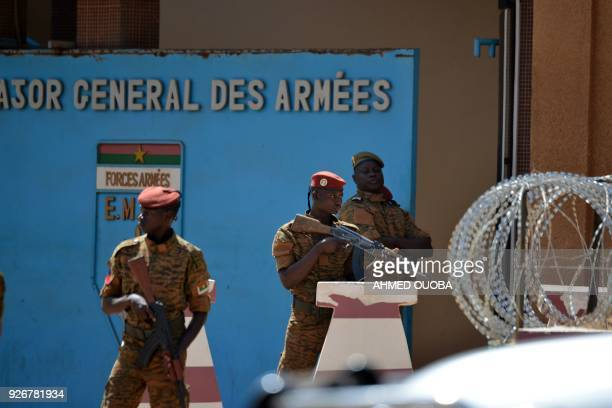 Burkinabe soldiers patrol the army's headquarters in Ouagadougou on March 3, 2018 a day after dozens of people were killed in twin attacks on the...
