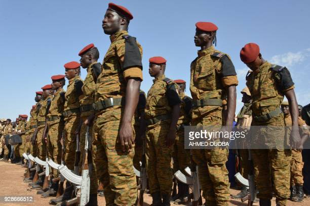 Burkinabe soldiers stand in line on March 7 in Ouagadougou, during a commemoration ceremony for eight Burkinabe servicemen killed in twin attacks ion...