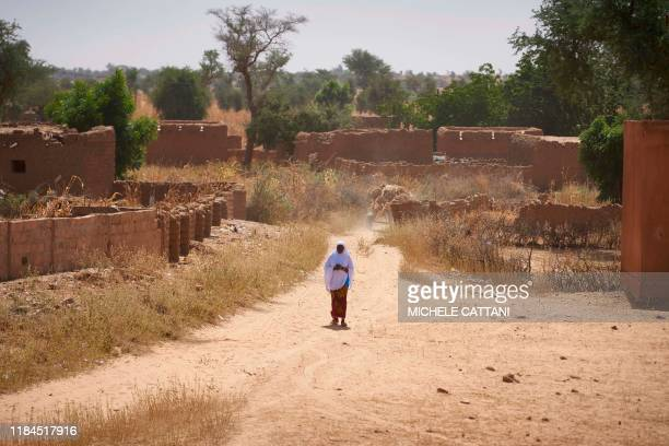 Burkinabe woman observes the passage of the French Army in Armoured Personnel Carriers during the Bourgou IV operation in a village in northern...