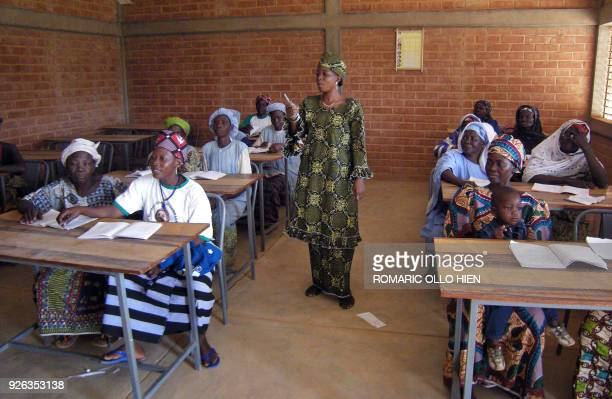 Burkinabese woman gives classes to women to learn writing and reading on March 7 2008 in a neighborhood of Ouagadougou where 85 percent of women are...
