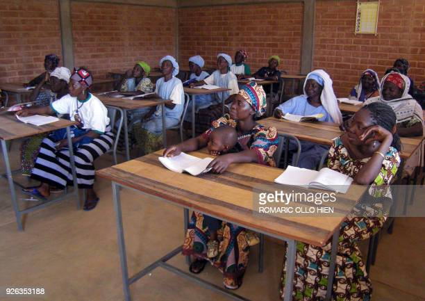 Burkinabese women attend lessons to learn writing and reading on March 7 2008 in a neighborhood of Ouagadougou where 85 percent of women are...