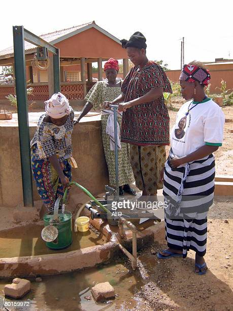 Burkinabese women pump water from a well as they learn to manage a market garden on March 7 2008 in a neighborhood of Ouagadougou where 85 percent of...