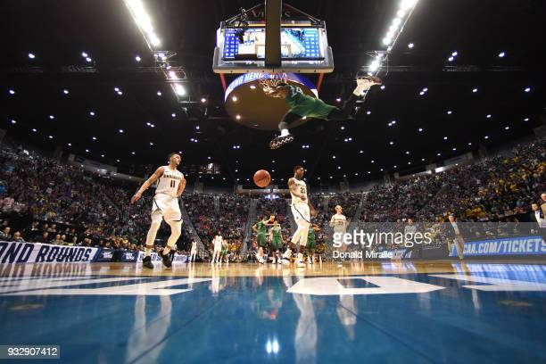 Burks of the Marshall Thundering Herd dunks in the second half against Landry Shamet of the Wichita State Shockers during the first round of the 2018...