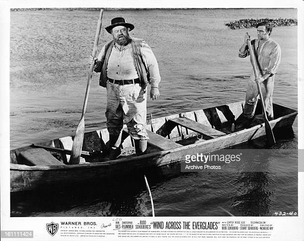 Burl Ives and Christopher Plummer row a boat in a scene from the film 'Wind Across The Everglades' 1958