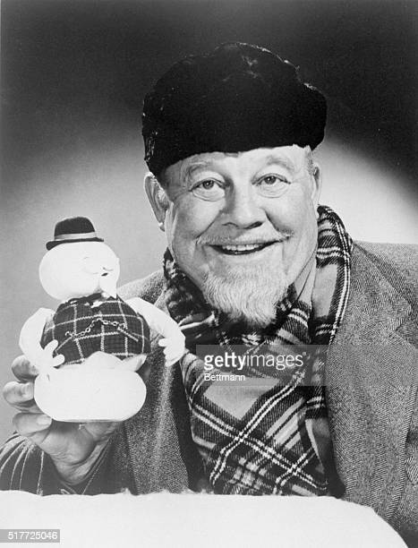 Burl Ives holds up the stopmotion snowman puppet of Sam whose voice he provides in the TV Christmas special Rudolph the RedNosed Reindeer