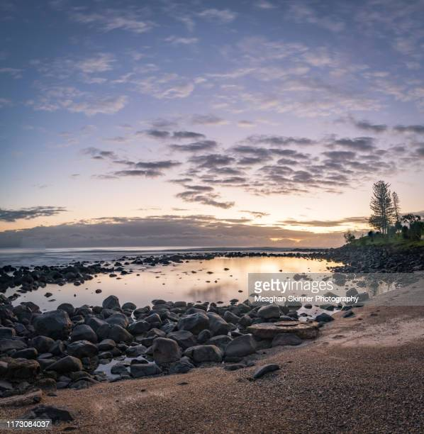 burleigh heads sunrise over the beach, gold coast - moody sky stock pictures, royalty-free photos & images