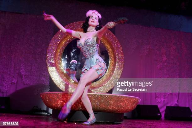 Burlesque artist and actress Dita von Teese performs at the 'Chopard Party' party at the Carlton Hotel during the 59th International Cannes Film...