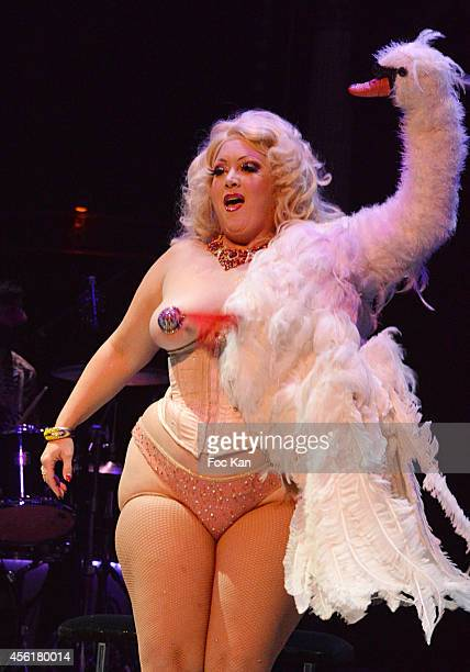 Burlesque artist Dirty Martiniperforms during the Cabaret New Burlesque Show at the Cirque D'Hiver on September 26 2014 in Paris France