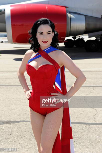 Burlesque artist Dita Von Teese poses on the tarmac in front of a Virgin Atlantic Airways 747400 aircraft at McCarran International Airport as part...