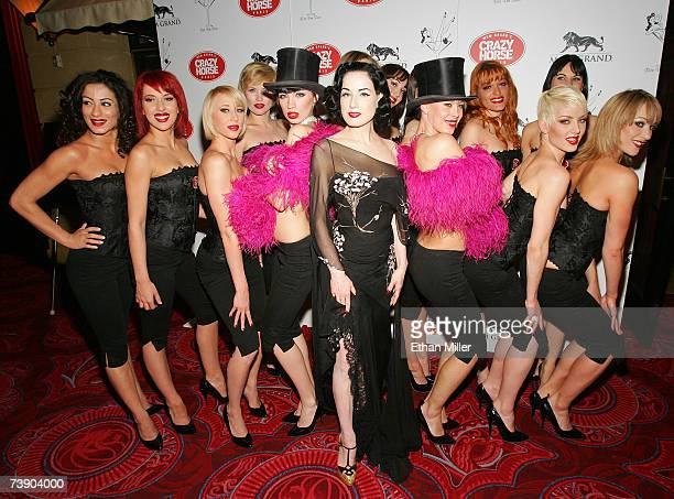 Burlesque artist Dita Von Teese poses with dancers from the MGM Grand's Crazy Horse Paris show April 16 2007 in Las Vegas Nevada Von Teese is a guest...