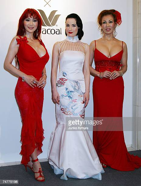 Burlesque artist Dita von Teese poses with Mika Kanou and Kyoko Kanou at the opening night party for the 'Very Lingerie Week Dita Von Teese Photo...